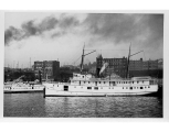 Sidewheel steamer GEORGE E. STARR and steamer ROSALIE adocked at the foot of University St.,...