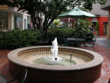 Round water fountain and seating area