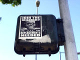 "Join the Military-Replacements needed"" poster on traffic light"