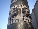 "Two Join the Military-Replacements needed"" posters on pole"