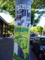 "Join the Military-Replacements needed"" posters on pole with ripped event poster beneath"
