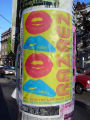 Bright mulitcolored event poster on pole