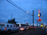 Aurora Plumbing & Electric Supply plunger sign, wide shot