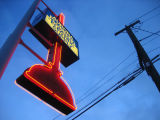 Aurora Plumbing & Electric Supply plunger sign, low angle