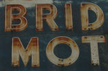 "Bridge Motel sign, detail - ""BRID MOT"""