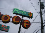 Puetz Golf sign on Aurora Ave, skewed with power line, detail