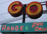 "Puetz Golf sign on Aurora Ave, detail of ""GO"" and ""Range"""