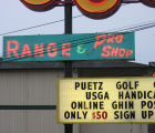 "Puetz Golf sign on Aurora Ave, detail of ""Range"" and reader board"