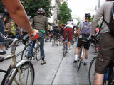 Critical Mass going eastbound and uphill on Pike St.approaching the intersection with 6th Ave.