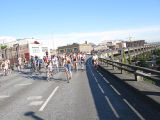 Critical Mass participants ride north on the top deck of the viaduct