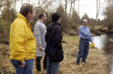 Professor Dan Jaffe instructing students in stream measurements