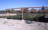 Cold frames used to house container plants used in wetlands restoration