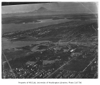 Aerial of campus from the northwest showing Mt. Rainier in background, University of Washington,...