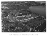 Aerial of Husky Stadium and Edmundson Pavilion on game day, University of Washington, ca. 1955