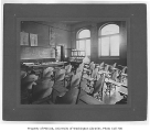 Administration Building (now Denny Hall) interior showing classroom, University of Washington, ca....