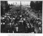 Crowd, probably leaving Husky Stadium after a game, University of Washington, ca. 1960
