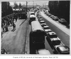 Cars and buses lined up on Montlake Boulevard, probably on game day, University of Washington, ca....