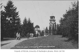 Students on sidewalk near Observatory and Chimes Tower, University of Washington, ca. 1910