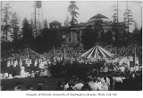 Crowds with maypoles, probably at May Fete, University of Washington, ca. 1914