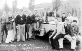 1932 Campus Day showing students around a car, University of Washington