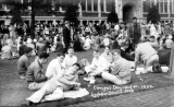 1932 Campus Day showing students eating on the grass, University of Washington