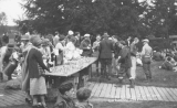 1925 Campus Day showing students with beverages, University of Washington