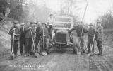 1923 Campus Day showing students with shovels and a car, University of Washington