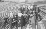 1922 Campus Day showing students with brooms in the bleachers, University of Washington