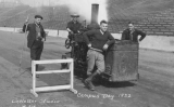 1922 Campus Day showing students with groundskeeping equipment on the track, University of...