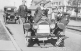 1921 Campus Day showing students on a car, University of Washington