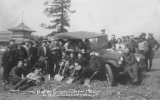 1920 Campus Day showing students with shovels and a car, University of Washington