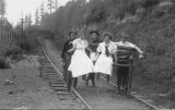 1910 Campus Day showing students on railroad tracks, University of Washington