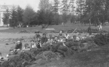 1917 Campus Day showing students with rakes and pipes, University of Washington