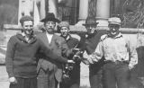 1917 Campus Day showing students holding an unidentified tool, University of Washington