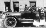 1916 Campus Day showing students with a car, University of Washington