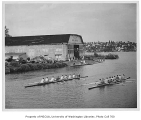 Crews rowing near old shellhouse, University of Washington, n.d.