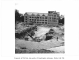 Communications Building excavation showing Thomson Hall in background, University of Washington,...