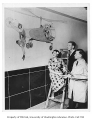 Ernest Norling with students painting mural in cafeteria of Husky Union Building (HUB), University...