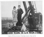 Two students at groundbreaking for Edmundson Pavilion, University of Washington, ca. 1927