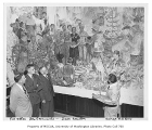 Artist Ernest Norling showing mural to President Raymond Allen, Don Emanuels, and Dean Herbert...
