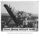 Students posed on construction equipment at groundbreaking for Edmundson Pavilion, University of...