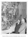 Dean Herbert Condon and President Raymond Allen looking at mural in Husky Union Building (HUB),...