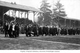 Football fans parading at Denny Field with the Hook, University of Washington, ca. 1913