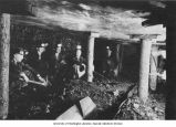 Five men sitting in a mine,  n.d.