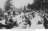 Students seated outdoors at table during celebration of Campus Day, Unviesrty of Washington, 1909