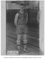 Irving Cook, captain of basketball team, University of Washington, 1919