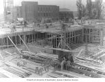 Framing the basement and first floor during construction of the Electrical Engineering Building,...