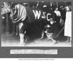 Students dressed in cow costume as part of festivities preceding the University of Washington vs....