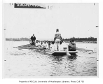 Freshman crew with coach Al Ulbrickson in practice boat, University of Washington, ca. 1935