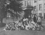 Large group of Clarke Hall residents in front of Clarke Hall, the women's dormitory, Spring 1921